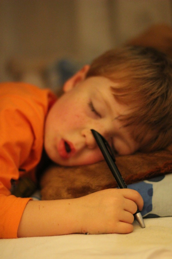 Sleeping child with pen
